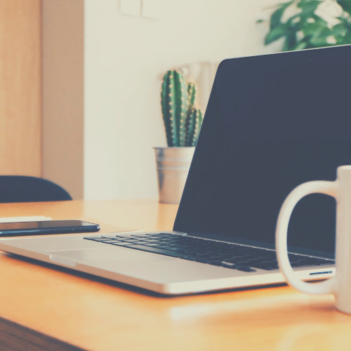 Smartphone, Laptop and Coffee mug on a desk
